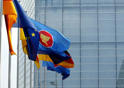 Flags of EU and ASEAN members wave in fr