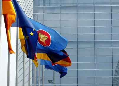 Flags of EU and ASEAN members wave in fr