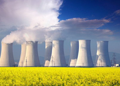 16218021 - nuclear power plant with yellow field and big blue clouds